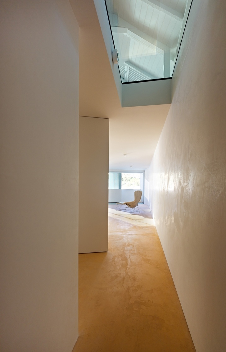 Hallway with glass floor in Lavender Bay Boatshed by Stephen Collier Architects