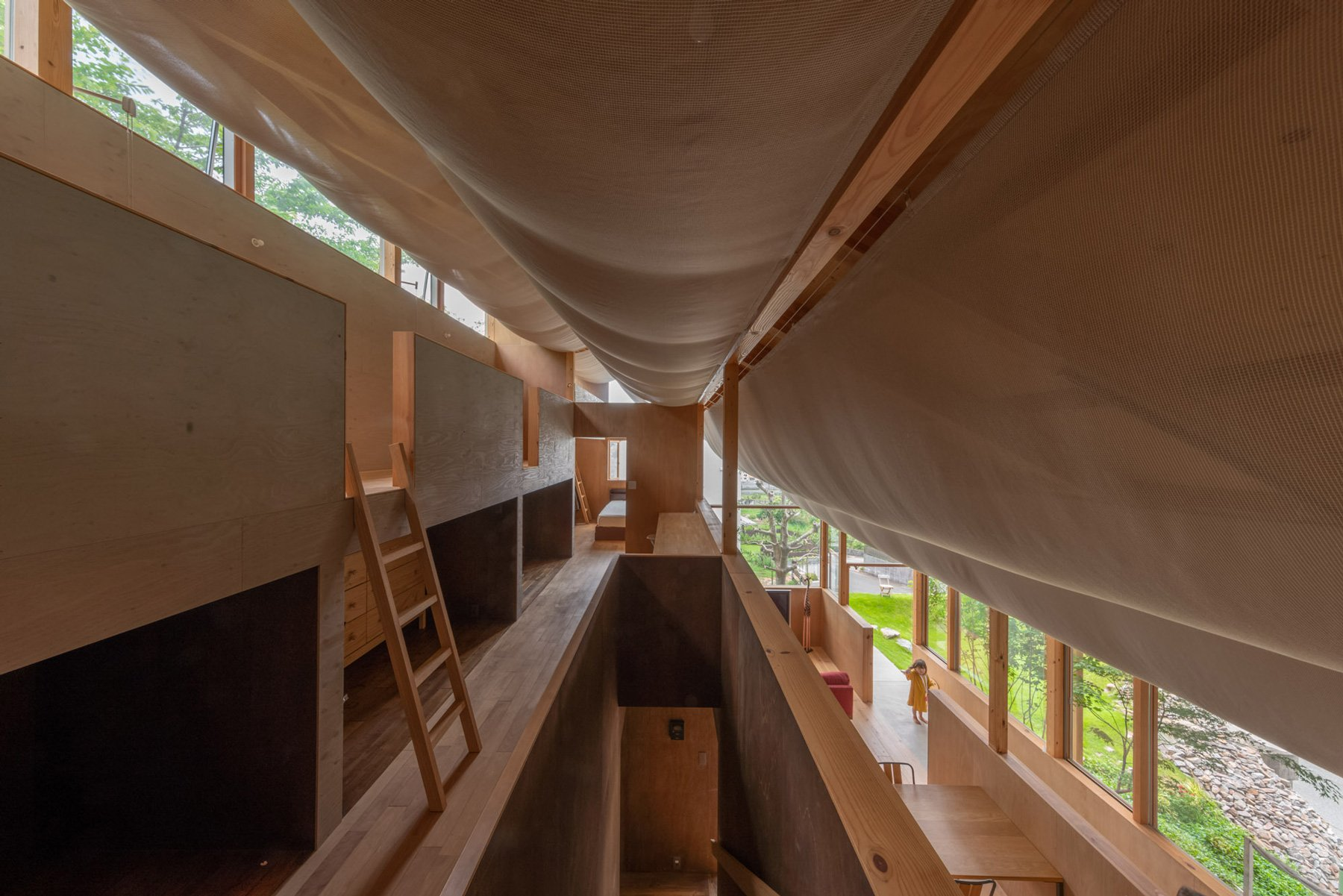 takayuki suzuki architecture atelier drapes sheer fabric across the ceiling of japanese house
